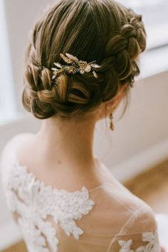 Real Inspiration for the Perfect Wedding Updo | Clean and classic yet oh-so-romantic, this French braid wedding updo ensures your hair looks stunning all day! No worries about your hair losing its curl or falling flat.