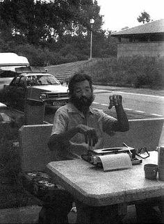 Argentinian novelist Julio Cortazar with an Olympia Traveller typewriter.