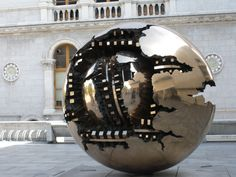 Sphere with Sphere by Arnaldo Pomodoro at Trinity College, Dublin, Ireland