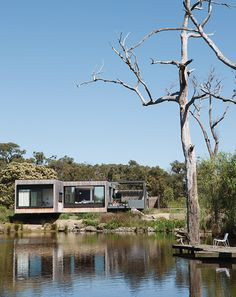 Perched above a lake on Australia's verdant Mornington Peninsula, James and Imogen Tutton's teak-clad house was designed by Karen Alcock of Melbourne-based MA Architects.
