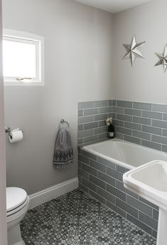 Metro tiles, star shaped mirrors, Moroccan floor tiles, and Moroccan style hand towel. Farrow & Ball's Ammonite paint and white sanitary ware. Metro Tiles Bathroom, Grey Bathrooms, Small Bathroom, Farrow And Ball Living Room, Ammonite Paint, L Shaped Bathroom, Modern Vintage Bathroom, Hallway Decorating, Colors