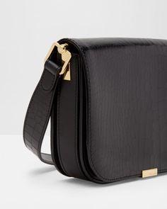 d8480e6f610f Metallic bar leather shoulder bag - Black