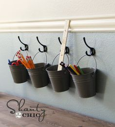Kids Art Supply Buckets on Hooks spraypaint already owned tin buckets and hang on hooks over Jace's desk for supplies Tin Buckets, Galvanized Buckets, Diy Rangement, Toy Rooms, Craft Rooms, Wall Storage, Corner Storage, Hanging Storage, Toy Storage