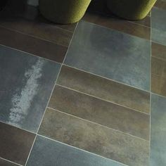 ceramic tile with metallic granules for a chic, industrial-meets-natural look.