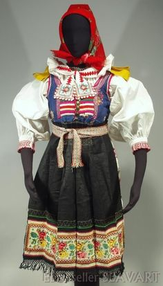 The blouse is embroidered with red and blue floral motifs on the shoulders and has a handmade embroidered and crocheted collar. The skirt is pleated around the back and flat on the front in the are where it is covered by the apron. Folk Costume, Costumes, Folk Embroidery, Embroidered Blouse, Folk Art, Red And Blue, Apron, Vest, Skirts