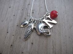 "Nebraska Huskers Charm Necklace-Football Helmet Charm, Corncob Charm, Football Charm, ""N"" Charm, and Red Accent Bead- Football Necklace on Etsy, $25.00"