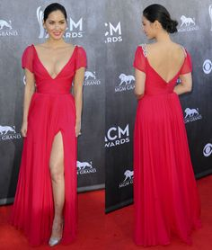Olivia Munn at the 2014 ACM Awards wearing a red Reem Acra gown with matching silver Christian Louboutin sandals and Neil Lane diamond drop earrings.