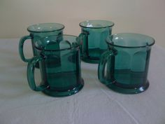 Green Coffee Mugs (4) in TheDiva's Garage Sale in Crown Point , IN for $15.00. 10 oz. Green Glass Coffee mugs.  Got them to match my dinner wear but I never use them.