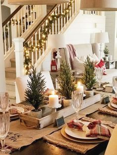 Festive Rustic Farmhouse Christmas Decor Ideas to Make Your Season Both Merry and Bright. Country Christmas Decoration ideas perfect for your holiday party this holiday season! Christmas Table Settings, Christmas Tablescapes, Christmas Candles, Christmas Table Centerpieces, Centerpiece Ideas, Holiday Tables, Christmas Lights, Christmas Staircase, Farmhouse Christmas Decor