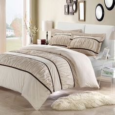 Refresh your master suite or guest room with this cozy duvet cover set, showcasing a ruffled stripe for stylish appeal. Product: ...
