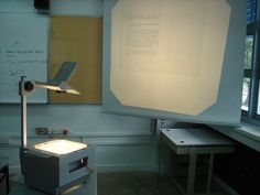 Taking notes in school off the overhead projector.