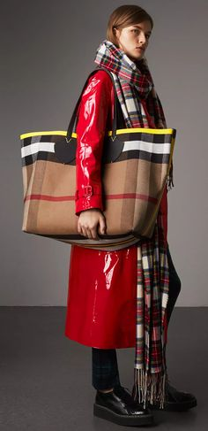 A supersized reversible Burberry tote in canvas check cotton bonded to supple leather. The unisex bag has contrasting sealed seams for an extra clash of colour #TheGiant