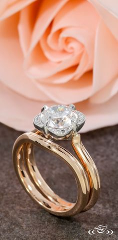 This rose gold wedding band curves perfectly around the bloom of this engagement ring. Green Lake Jewelry