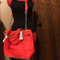"""Light  up the Room"" Tote NWT. This large purse boasts lot of room and style. It has an orange-y red color with yellow accents. Sure to light up the room. Magnetic top closure. Has optional shoulder strap. Inside is one large opening. No zippers or pockets. Beautiful. JustFab Bags Totes"