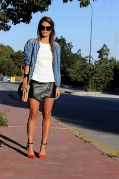 Lovely denim shirt with a simple white tee and a leather zipped mini skirt with a pair of orange heels.