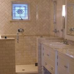"Shower area - tumbled marble subway tile. traditional ""brick"" on the bottom, herringbone on the tob"