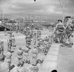 Troops of the Division boarding landing crafts at Catania, Sicily for the invasion of the Italian mainland/September 1943 - pin by Paolo Marzioli Italian Campaign, Landing Craft, British Armed Forces, D Day, World War Two, Old Pictures, Love Photography, Ww2, Catania Sicily