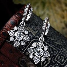 SHARE & Get it FREE | Pair of Vintage Faux Crystal Rhinestone Hollow Out Floral Earrings For WomenFor Fashion Lovers only:80,000+ Items • New Arrivals Daily • Affordable Casual to Chic for Every Occasion Join Sammydress: Get YOUR $50 NOW!