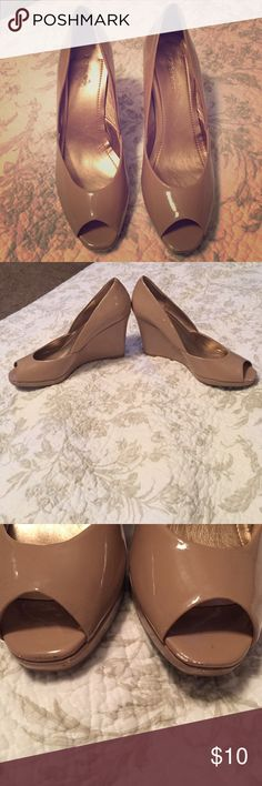 BCBG Generation peep toe wedges. Shiny nude. Classic peep toe nude wedge. Perfect for work or play. Minor signs of wear on toes shown in pics. Otherwise, look great. BCBGeneration Shoes Wedges