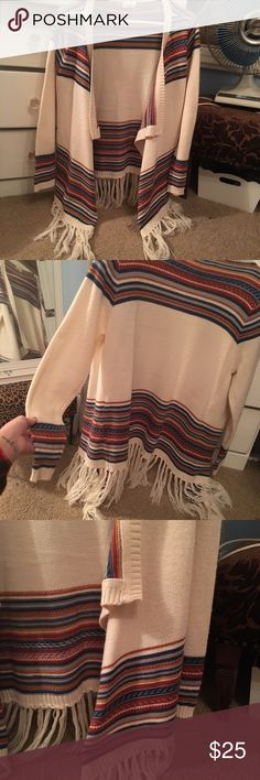 Tea & Cup multi colored sweater with fringe Size small/medium. Cozy cream colored sweater with multi colored detail. Tea & Cup brand but bought at a local boutique. Great condition only worn a few times. Tea n Cup Sweaters Shrugs & Ponchos