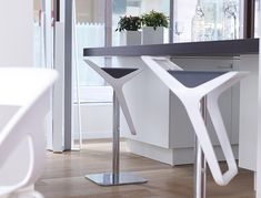 Interesting contemporary bar stools for modern kitchen design ideas: contemporary bar stools with white armchair