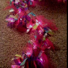 Purple Christmas lights with tulle, fabric and ribbon.