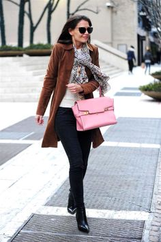 Katie Holmes adds the perfect '70s touch to her black skinny jeans with a suede trench, silk scarf and Hermes satchel.