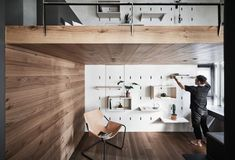 Apartment X, Taiwan, by KC Design Studio. A clever pegboard-like wall design was used to create adaptable storage in this apartment in Taiwan. The owner of the 46-square metre apartment can add shelving to the wall and use it to display and store books and decorative items.