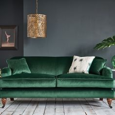Agatha Velvet Sofa - Emerald Green Our bestseller! The Agatha 3 Seater Sofa comes in over 20 colours to choose from. Designed and made by hand in our workshops in South Wales, we only use quality hardwood and the finest fabrics. Blue Velvet Sofa Living Room, Green Velvet Sofa, Living Room Green, Green Rooms, Living Room Sofa, Living Room Interior, Home Living Room, Living Room Designs, Living Room Decor