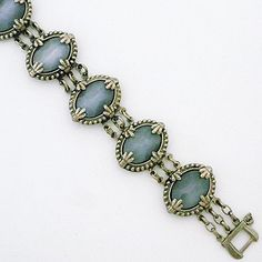 Sorrelli Seaside Collection. Vintage Sorrelli classic bracelet style. Oval vintage brooches create a fabulous vintage bracelet with grey cabochon stones.