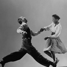 Photo of Leon James and Willa Mae Ricker demonstrating a step of The The Lindy (lindy hop). Life Magazine.