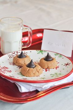 """Flourless Peanut Butter Kiss Cookies - 1 cup smooth peanut butter (Jif's creamy natural), 1/2 cup packed light brown sugar, 1 egg, 1/2 teaspoon vanilla extract, 14 Hershey's dark chocolate kisses. Beat first four ingredients together. Make into balls and place 2 """" apart on cookie sheet. Bake 10 -12 mins. at 350 degrees. Press chocolate kiss gently into center of cookie. Cool for 10 mins. Enjoy!"""