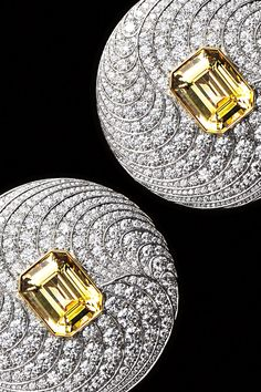 Sheer radiance. Earrings in platinum and 18k yellow gold with unenhanced emerald-cut yellow sapphires, 13.54 total carats, surrounded by round brilliant diamonds.