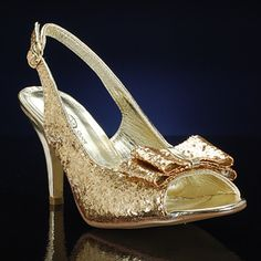 FL0 4156 by LAVA is a classy style that will fit with nearly any outfit! Reminiscent of a gold Kate Spade shoe, this gold heel has a perfect bow at the peep toe. The adjustable slingback strap provides excellent comfort for a night out. Flo also comes in silver. $64.95 promshoes.com Gold Prom Shoes, Prom Heels, Wedding Shoes, Wedding Stuff, Dream Wedding, Metallic Shoes, Bridesmaid Shoes, Lava, Going Out