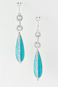 Gorgeous Teardrop of striking Turquoise is accented with Austrian Crystals on these chicly elegant Earrings