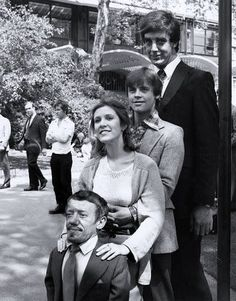 Kenny Baker ( R2-D2 ), Carrie Fisher ( Princess Leia ), Mark Hamill ( Luke Skywalker ), Peter Mahew ( Chewbacca ) in a Star Wars behind the scene photo