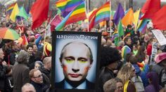 A demonstrator holds up a picture depicting Russian President Putin with make-up during a protest by the gay community in Amsterdam. It's time this creepy little man was forced to give up the (suspect) strongman stance he has mistakenly tried to cultivate at the expense of others: women, gay people, journalists – whole countries – the Syrians, Georgians and ethnic Chechens, the list goes on....
