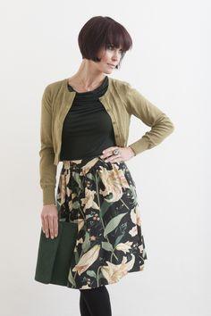 Sandwich cardi,  top,  Hoss Intropia silk skirt  all Farhi by Nicole Farhi     Suede clutch, jewelled ring, all Figis, Tenterden
