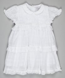 A divine white girl's christening dress by Kidiwi with a smocked bodice and frill on sleeves and skirt.  Featured in Vogue magazine October 2014 #christening dress #baptism dress #designer christening dress #vogue christening dress #girl's christening outfit #girl's baptism outfit