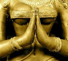 Gold Namaste statue...     with underboob, apparently!