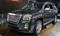 2015 GMC Acadia Denali.. looking into this for our family of 6!