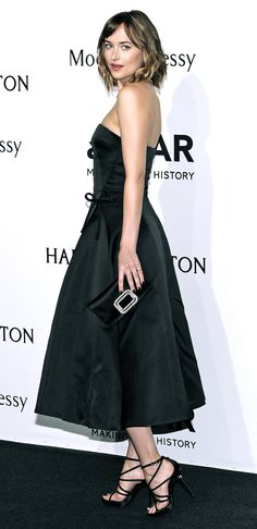 Dakota Johnson at the amfAR gala photo call in Milan - 26 Sep 2015