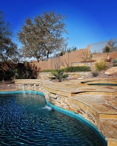 Backyard finished for this hillside lot. Layering the planters all the way up with the pool having natural flagstone to blend into the environment. #houzz #luxury #photooftheday #waterfeature #pool #swimmingpool #landscape #design #architecturephotography #architecture #az #homes #backyard #tile #glass