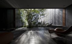 Modern take on a Japanese courtyard at Hiroshi Nakamura's, Optical Glass House in Hiroshima