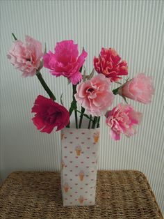 Ice-cream colours in crepe flowers and a card vase