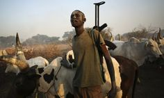 A young cattle herder from the Dinka tribe carries his AK 47 rifle near Rumbek, capital of the Lakes State in central South Sudan. Photograp...