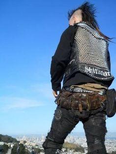 Enjoying that belt, male punk, punk vest, shitlicker