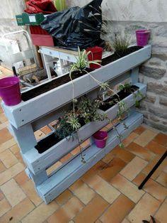 Porte plantes en palette... ...