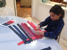 We taped down one end of the strips so they would stay put then we carefully began to weave the strips in and out starting from the top following the same order as our key again. You can also hold the fabric in place using the thumb tacs and foam board.