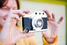 When I get an iPhone 5s I want one of these. Then I hope I'll be able to wear my camera around my neck :-) The iPhone Rangefinder - The Photojojo Store!